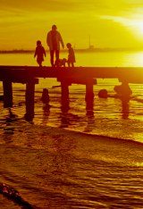 Family on the pier at sunset